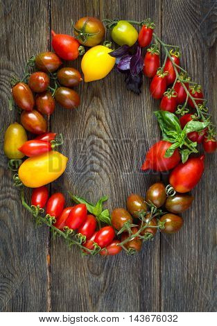 Beautiful wreath of fresh ripe heirloom tomatoes.