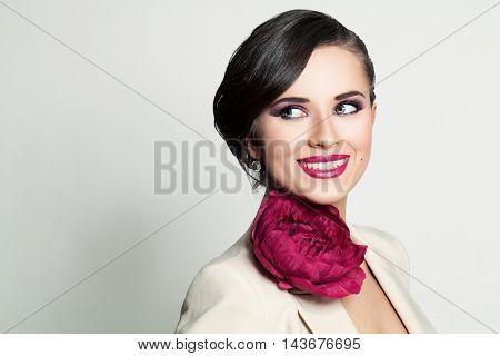 Beautiful Smiling Woman on gray. Happy Fashion Model