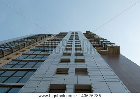 high-rise apartment building on the sky background