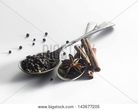 peppercorn, anise star and cinnamon stick on the white background