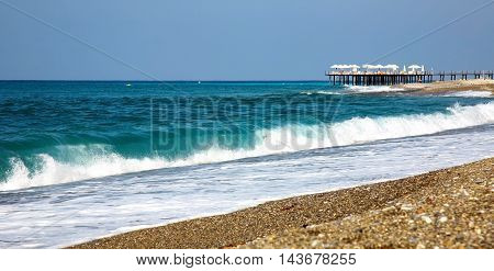Waves and stony beach in the resort of Alanya in Turkey