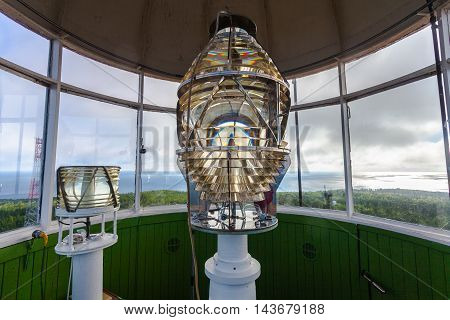 Lighthouse glass lamp and view on the sea