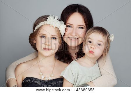 Happy Family. Mother and two Children Hugging