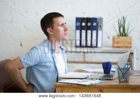Young Office Man Suffering From Backache