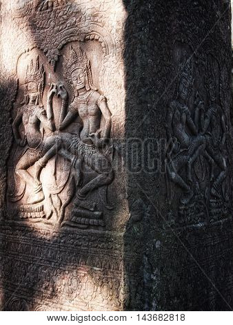 Wall carving in Angkor Wat temple complex in Siam Reap, Cambodia.