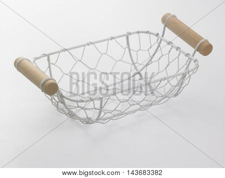 white wire basket on the white background