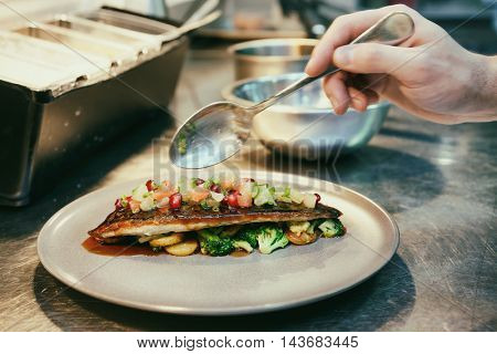 Chef is decorating a delicious appetizer, motion blur, toned image