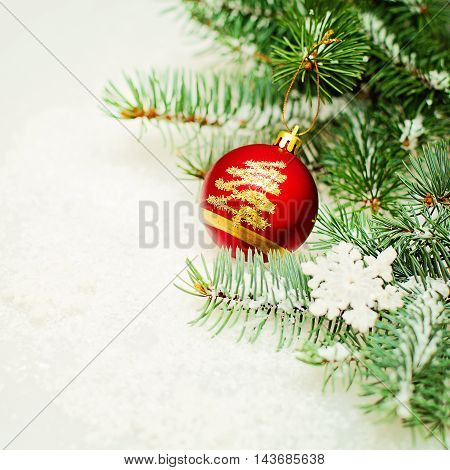 Christmas Tree Twig and Red Ball Xmas Decor on White Background. Christmas Background