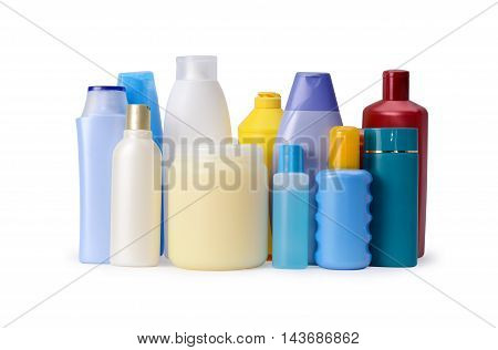 Group of shampoo or body care bottles isolated on white background. Assortment of hygiene products
