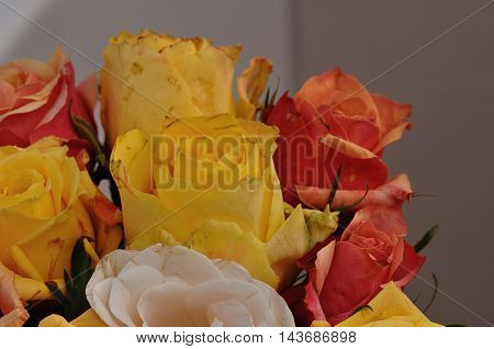 A bouquet of colorful yellow and orange roses