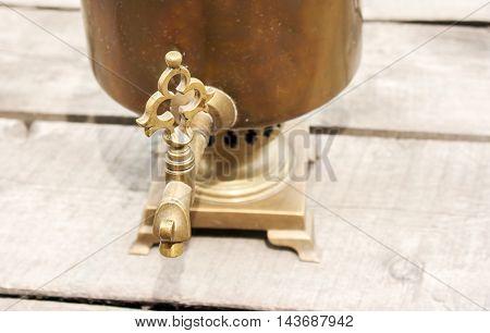 faucet of old vintage bronze samovar closeup