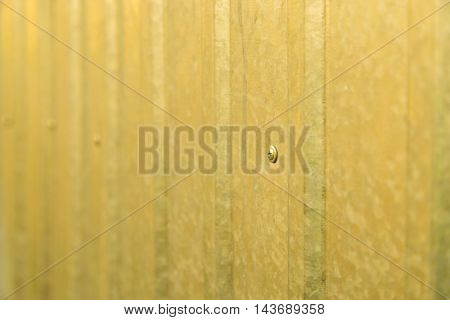 Texture background of yellow corrugated metall fence
