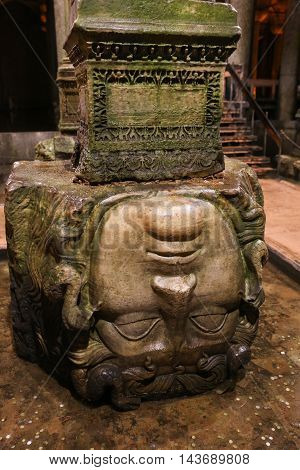 ISTANBUL TURKEY - JULY 28 2016: Medusa columns base inside Basilica Cistern. The Basilica Cistern is the largest of several hundred ancient cisterns that lie beneath the city of Istanbul.