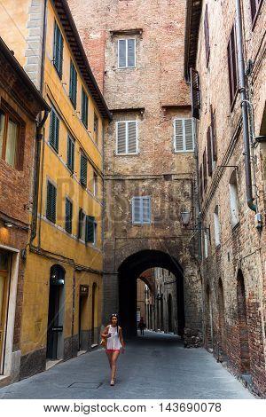 Street Scene In The Old Town Of Siena
