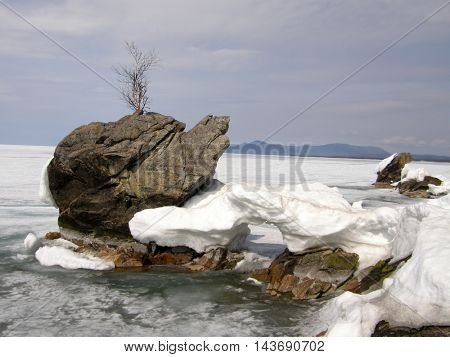 Ice-covered Lake Baikal. Spring. The end of April.