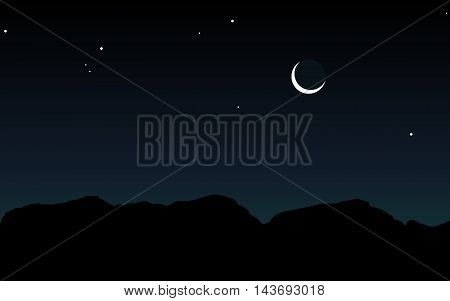 Silhouette of mountains against the sky with stars and moon.