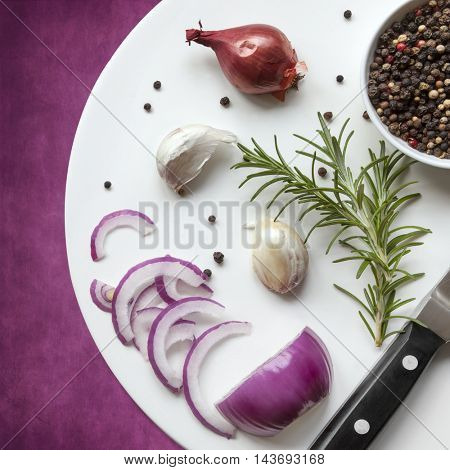 Food background top view, with red onion, rosemary, garlic, peppercorns.