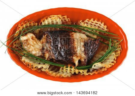 roast meat on red bowl served over white