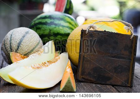 Various Melons With Empty Sign