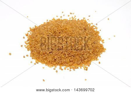 Bulgur grains pile isolated on white background