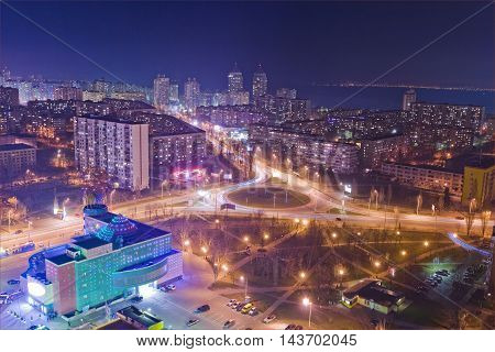 Highway at night in modern city. Aerial view of cityscape.