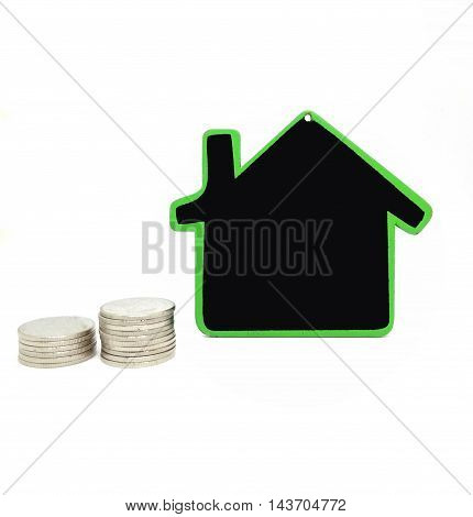 Mortgage concept with money house from the coins
