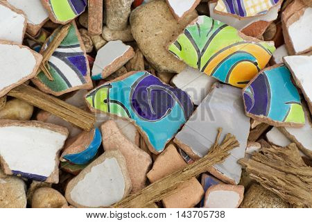 Many pieces of broken colorful ceramic tiles