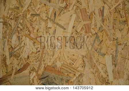 Close up of a recycled compressed wood chipboard Useful as background