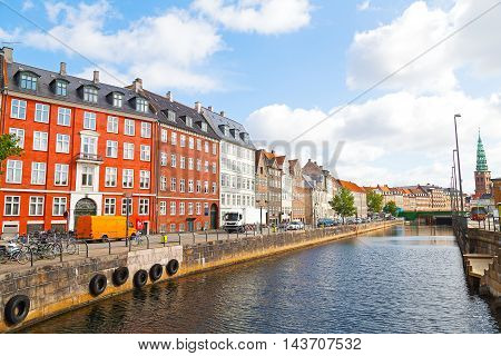 Waterfront city buildings along the canal in Copenhagen Denmark. European city life during summertime.