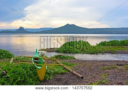 Phishing boat on a shore of beautiful Lake Taal Philippines. Landscape of Luzon Island with volcano on the lake that changed the area geometry a few centuries ago.