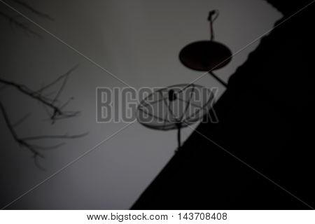 abstract of blur of satellite dish in dark scene