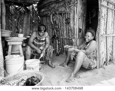 KARA, TOGO - MAR 9, 2013: Unidentified Togolese women sit near their  house. People in Togo suffer of poverty due to the unstable econimic situation