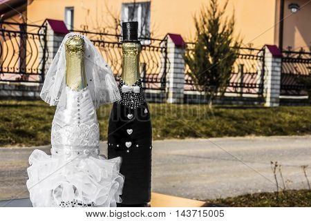 Champagne bottles decoration for wedding day (bride and groom )