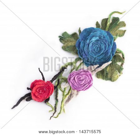 Three brooches from felted wool on a white background