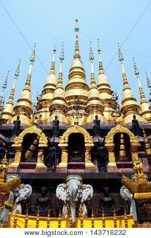 Thai gold pagoda with blue sky when mid day