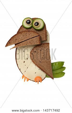 Funny crow made of bread and cheese on isolated background