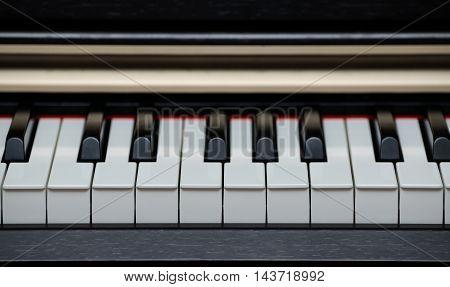 Digital electric piano keys close up .