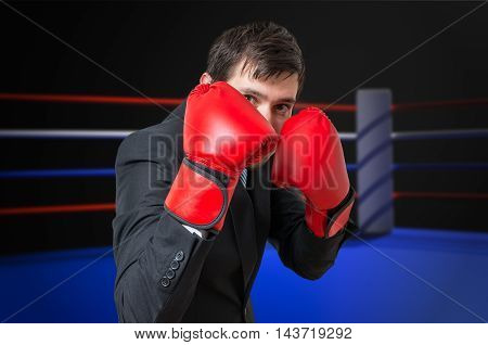 Businessman Is Fighting And Hiding His Face In Ring.