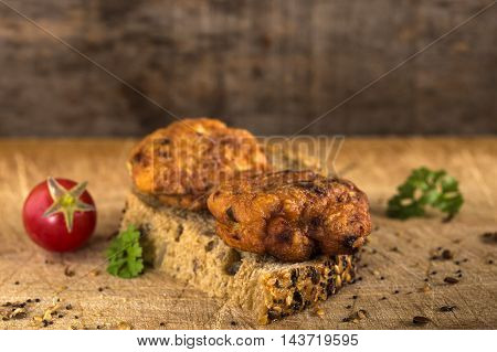 Fresh chicken meatball sandwich with tomato and herbs
