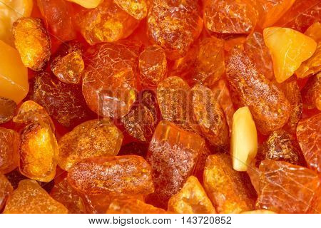 closeup amber stones rectangular lie on a flat surface