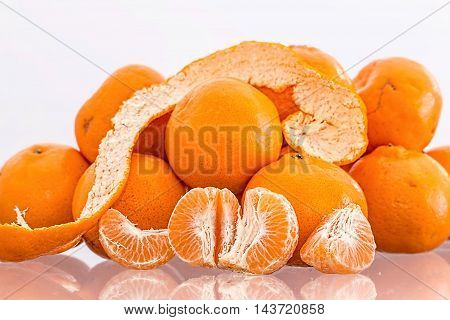 orange snack mandarin tangerine yellow isolated diet cutout healthy vegetarian food health refreshment ripe tasty juicy tropical fruit peel vitamin skin vegan unpeeled macro freshness organic dessert gourmet group eat whole fruity part tropic color sweet
