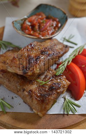 Plate of delicious spicy marinated grilled or barbecued spare ribs