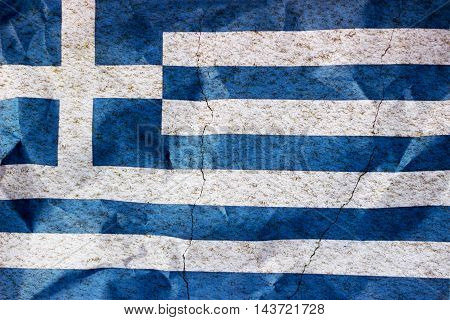 Flag of Greece on cracked wall - Finance concept