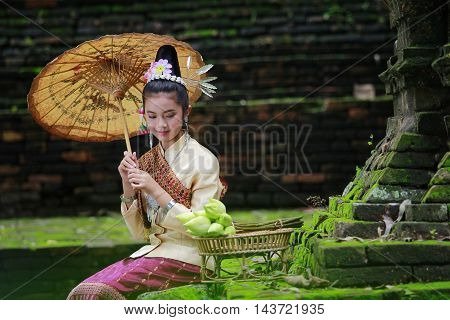The little girl with the old temples in Laos.
