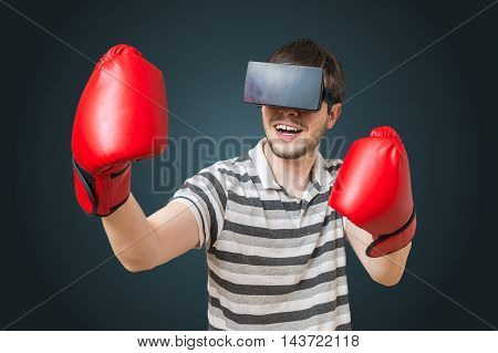 Young Man Is Playing Video Game And Is Boxing With 3D Virtual Re