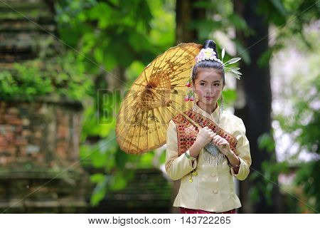 A little girl dressed in national costume, Laos in ancient temples.