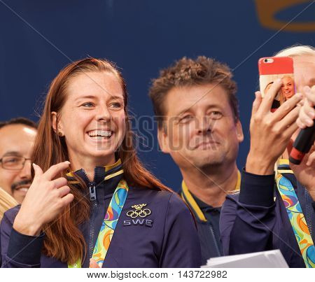STOCKHOLM SWEDEN - AUG 21 2016: Swedish soccer player Lotta Schelin winning olympic silver smiling when the swedish olympic athletes are celebrated in Kungstradgarden, Stockholm, Sweden, August 21, 2016