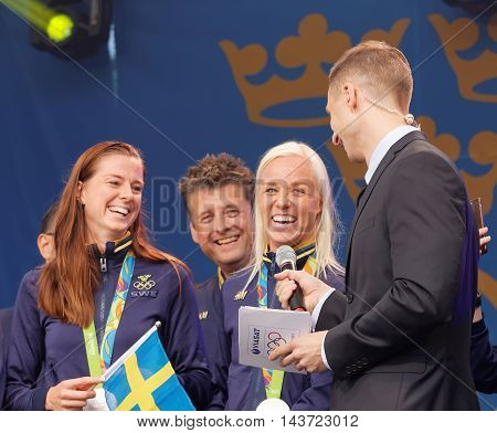 STOCKHOLM SWEDEN - AUG 21 2016: Swedish soccer player Lotta Schelin and Caroline winning olympic silver smiling when the swedish olympic athletes are celebrated in Kungstradgarden, Stockholm, Sweden, August 21, 2016