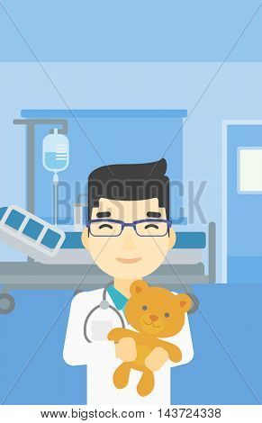 Young asian male pediatrician doctor holding a teddy bear. Professional pediatrician doctor with a teddy bear in the hospital room. Vector flat design illustration. Vertical layout.