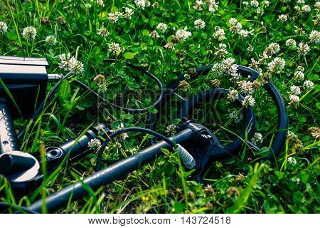 Old and retro metal detector on the grass